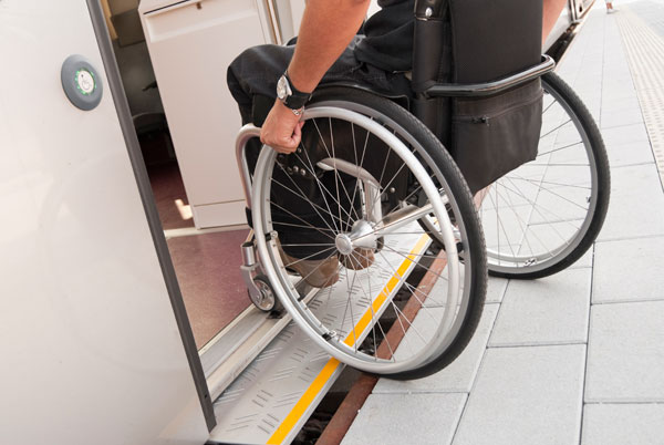 Man in wheelchair entering LRV